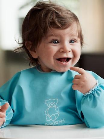 Barnförkläde i turkos - BABYBJÖRN