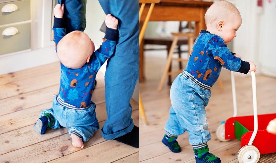 BABYBJÖRN Föräldramagasin – När börjar barn gå? Ett barn som lär sig att gå med hjälp av gåvagn eller förälderns hjälp.