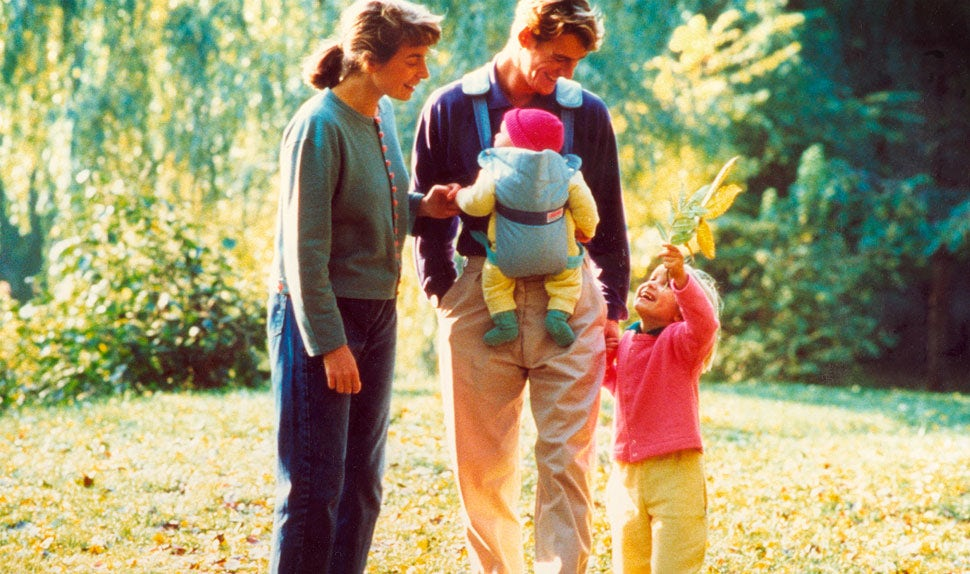 Family with Babybjorn baby carrier 80's