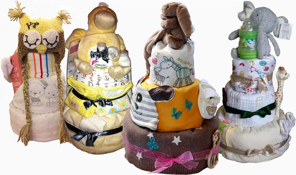 Magazine BABYBJÖRN – Le cadeau de baby shower dont tout le monde rêve, une pièce montée aux couches remplie de cadeaux.