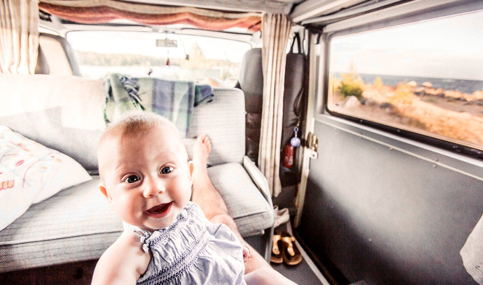 BABYBJÖRN Magazine for Parents – One of the twin girls inside the camper van.