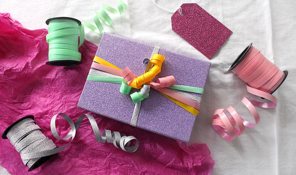 BABYBJÖRN Magazine – Presents wrapped in sparkly paper with multicolour ribbons.