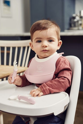 A perfect first baby bib, with a supersoft neckband in powder pink