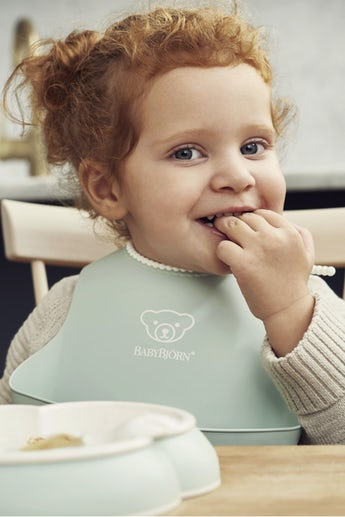 Baby Bib in Powder Green with a spill pocket for food that does not make it to the mouth.