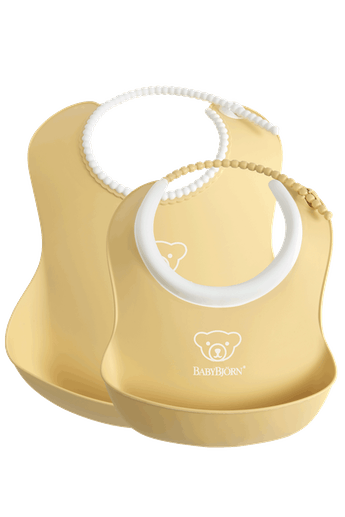 Feeding Bib set in 2 sizes, Powder Yellow - BABYBJÖRN